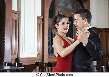 Argentine Tango Dancer With Man Performing Gentle Embrace -...