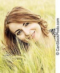Natural joyful woman posing in the wheat field, beauty in...