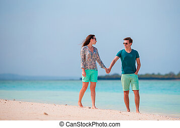 Young couple on white beach during summer vacation Happy...