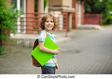 Pupil of elementary school stand in a half-turn to the...