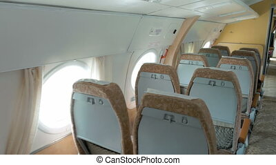Plane with clean and comfortable seats in beige. Traveling...