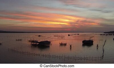 Beautiful sunset over fishermen water village in Thailand. Aerial video