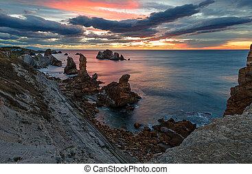 Sunset Atlantic ocean coastline near Portio Beach - Sunset...