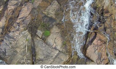 Slow motion aerial video of a beautiful waterfall in...