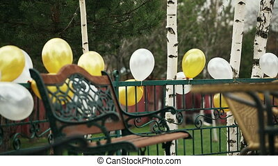a platform with benches decorated with balloons - a platform...