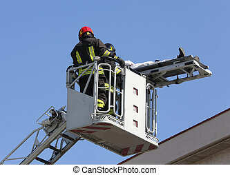 brave firefighters on the fire truck cage save the wounded...
