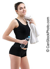 Young healthy fitness woman with towel and water