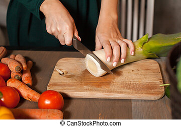 Start to cut with knife - Woman is starting to cut an onion...
