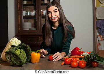 Tomato, knife and woman - Woman is going to cut a tomato at...
