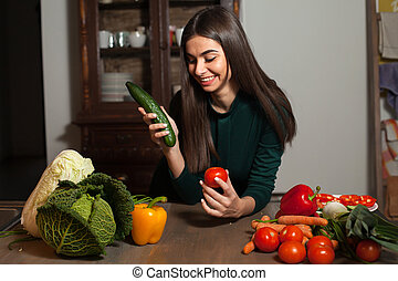Cucumber, tomato and woman - Woman takes a cucumber and a...