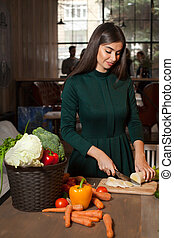 Onion and smilling woman - Smilling woman is cutting an...