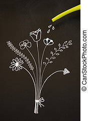 watering flowers on blackboard