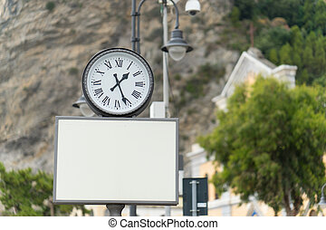 Blank billboard with analog clock for your design
