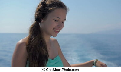Beautiful young girl on the deck of a ship
