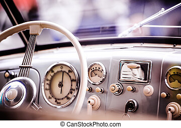 Close up of veteran car, dashboard, windshield, steering...