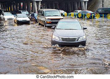 Flooded urban road - Car traffic in a heavy rain on a...