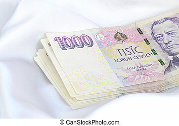 Czech banknotes thousand money currency on white satin...
