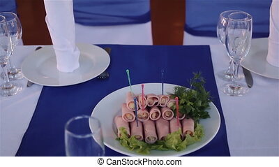 plate with rolls of ham - plate of rolls with ham and greens...