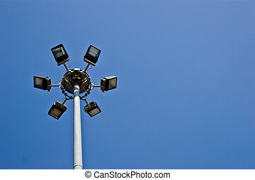 Light Projector - a light projector pole on a blue sky...