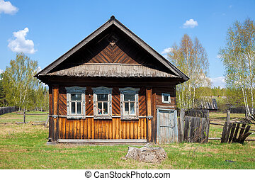 Old wooden house in a village - Old weathered log house and...