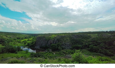 White Fluffy Clouds over the Canyon Central Ukraine...