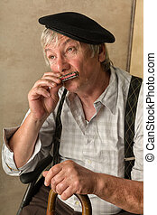 Old man with harmonica
