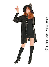 witch pointing with finger - Young woman with red hair as...