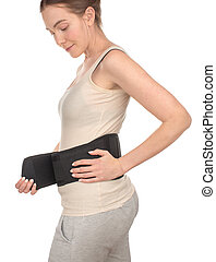 Woman putting wrapped sports medical belt, corset - Woman...