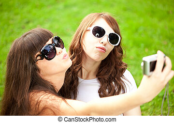 Duckface Selfie Two young trendy girls doing selfie A couple...