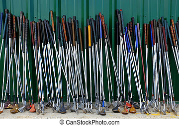 Row of Many Old Used Golf Clubs for Sport - Row of many used...