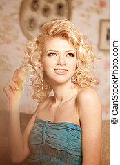 Beauty woman Face of a young beautiful smiling blondy girl