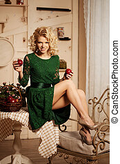 Young beautiful woman in a cafe Modern trendy blondy girl in...