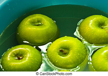Apples in the basin - Green apples are cleaning up in basin...