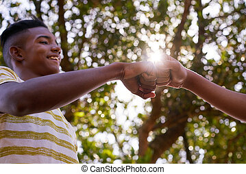 Black And White Teenagers Joining Hands Against Racism