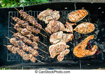 Grilled Foods Garnished Assorted chicken, salmon, meat...