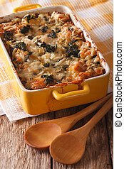 Strata casserole with spinach, cheese and bread close up...