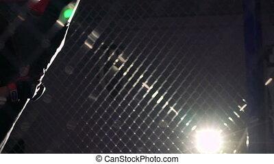 Boxer hitting punching boxing bag- mannikin in the dark gym...