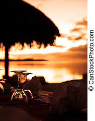 Wine glasses and tropical beach sunset - Wine glasses and...