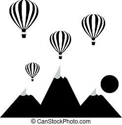 aerostats flying in the sky over the mountains at sunset