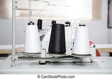 Thread Spools On Workbench At Factory - Black and white...