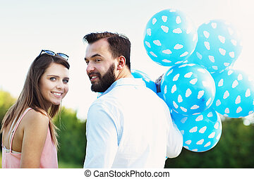 Romantic couple with baloons