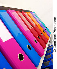Office - Colorful office folders on the bookshelf