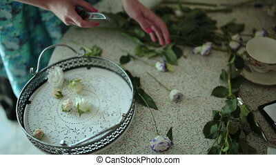 Florist prepares flowers for a floral composition - Florist...