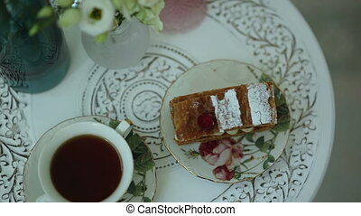 Tea and a piece of cake on vintage china sets - Vintage...