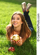 Woman with moneybox - Woman in the park on the green grass...