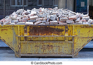 Skip with bricks - Over filled skip container with brick...