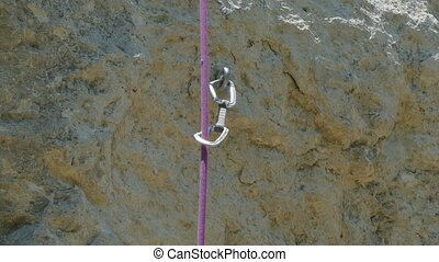 Climbing Rope Moving On Rock - CLOSE UP shot of a climbing...