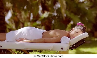 Calm woman laying face down on massage bench - Beautiful...