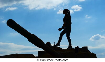 Training barbell biceps in the military. Silhouette of a...