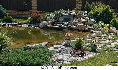 A pond in the garden - A landscape designer made some...